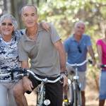 Elderly people riding their bikes