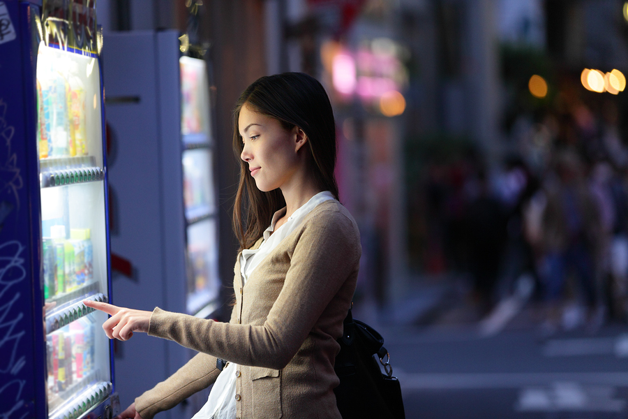 Japan vending machines - Tokyo woman buying drinks. Young studen