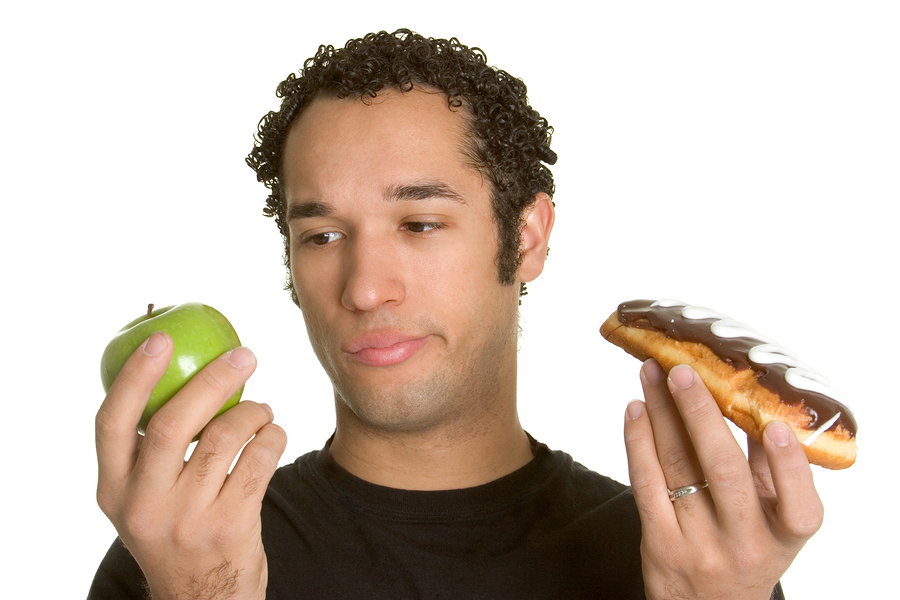 Young African American man holding onto food