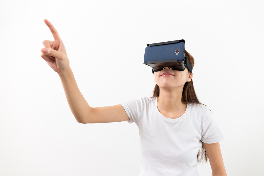 Young woman wear with with VR device and finger touch in air