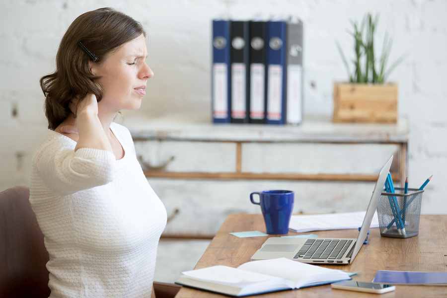 Young Office Woman Feeling Pain In The Neck